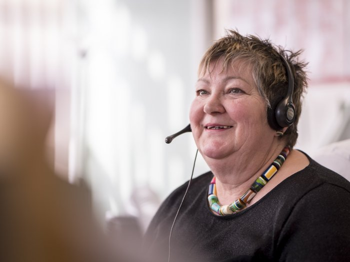Woman talking on headset, smiling